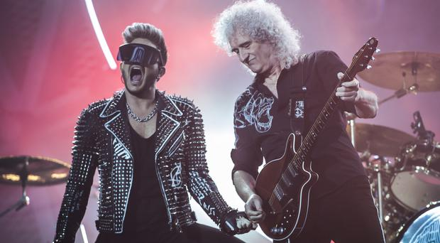 Adam Lambert, left, and Brian May of Queen during their headlining set at the Isle of Wight Festival