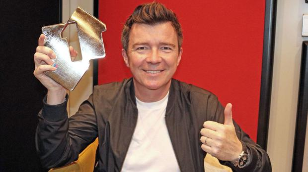 Rick Astley with his Number 1 Award after he claimed his first number one album since his debut nearly 30 years ago (OfficialCharts/PA)