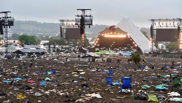 Rubbish in front of the Pyramid Stage after the Glastonbury Festival
