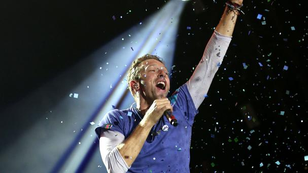 Chris Martin of Coldplay, performing live on The Pyramid Stage at the Glastonbury Festival