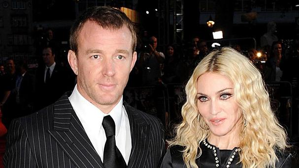 Guy Ritchie and Madonna have resolved their dispute