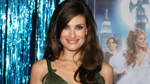 Idina Menzel says she isn't a role model for young girls.