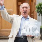 Ted McDermott outside Abbey Road Studios in London with a copy of his record, You Make Me Feel So Young. (16Decca Records/PA)