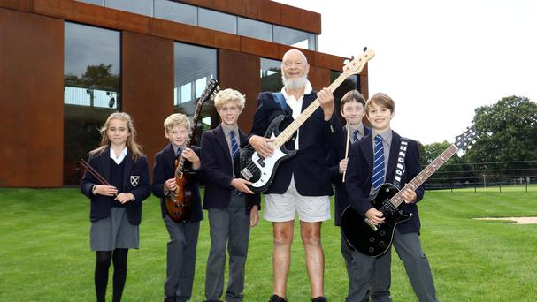 Michael Eavis outside the newly opened performing arts centre with some of the students (Carl Hewlett/TWM/PA)