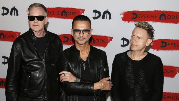 Depeche Mode pose for photographers at a press conference in Milan, Italy (AP)