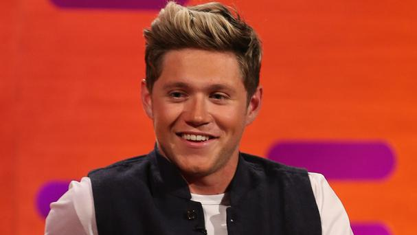 Niall Horan said he still misses his band-mates after they went their separate ways earlier in the year