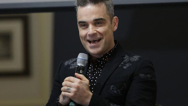 Robbie Williams is planning a 2017 stadium tour and says he would 'love to do Glastonbury again'