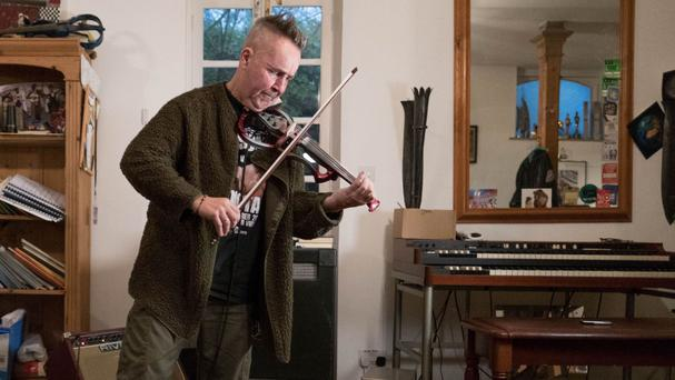 Violinist Nigel Kennedy performs at his home in north London