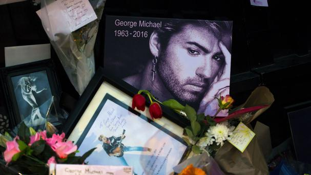 Tributes outside George Michael's house in Highgate, North London, UK, following the singer's death