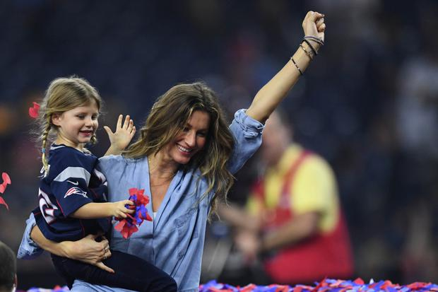 Victory dance: Gisele Bundchen and her daughter Vivian Brady celebrate