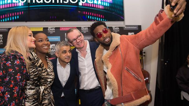 Mayor of London Sadiq Khan poses with Tinie Tempah, MTV presenter Laura Whitmore, singer Ray BLK and Viacom International CEO David Lynn