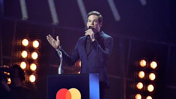 Michael C Hall collects an award on behalf of David Bowie at the Brit Awards