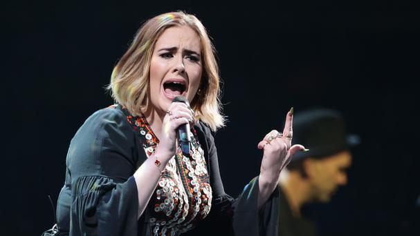 The impersonator sang lines from Adele's hit Rumour Has It as the singer clapped and danced along