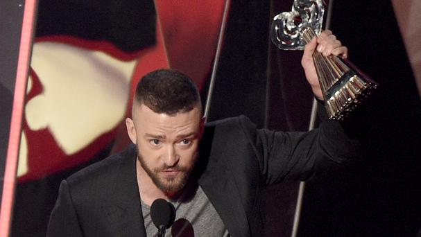 Justin Timberlake with the award for song of the year for Can't Stop The Feeling at the iHeartRadio Music Awards (Invision/AP)