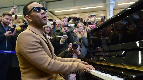 John Legend Stops to Perform at a London Train Station for Commuters