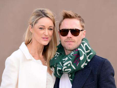 Ronan Keating with girlfriend Storm Uechtritz arriving for the Burberry Prorsum womenswear catwalk show at Kensington Gardens, as part of London Fashion Week. PRESS ASSOCIATION Photo. Picture date: Monday February 23, 2015. See PA story CONSUMER Fashion. Photo credit should read: Dominic Lipinski/PA Wire