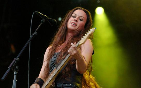 Canadian rock singer Alanis Morissette performing on the V Stage, on the first day of the V2002 music festival in Hylands Park, Chelmsford.