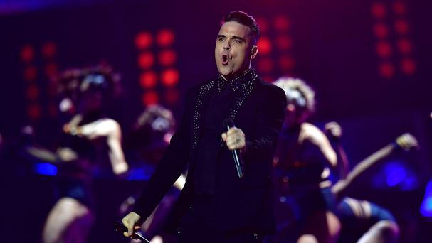 Robbie Williams has teased a new album (Dominic Lipinski/PA)