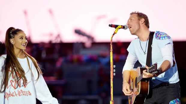 NO SALES. Free for editorial use. Handout photo issued by One Love Manchester of Ariana Grande and Chris Martin performing during the One Love Manchester benefit concert for the victims of the Manchester Arena terror attack at Emirates Old Trafford, Greater Manchester.