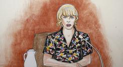 In this courtroom sketch, pop singer Taylor Swift speaks from the witness stand during a trial Thursday. (Jeff Kandyba via AP)
