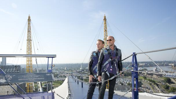 Matt (left) and Luke Goss of boy band Bros pose on top of the O2 Arena in London ahead of their comeback tour (Isabel Infantes/PA)