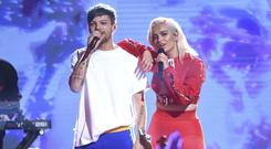 Louis Tomlinson and Bebe Rexha (Phil McCarten/AP)