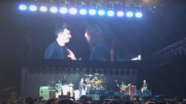 Astley onstage with Grohl