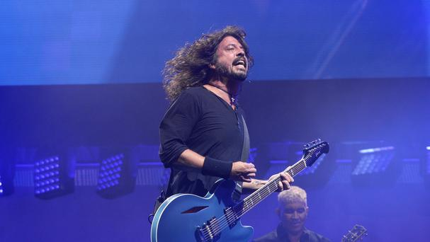 The Foo Fighters on stage at Glastonbury (PA)