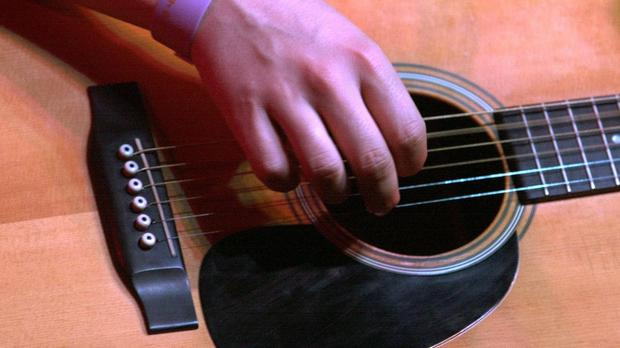 A guitar being played