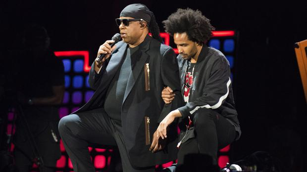 Stevie Wonder 'takes a knee for America' to support NFL amid Trump