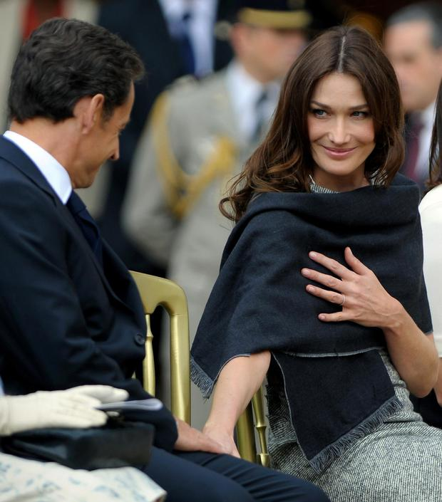 cd97401242 Carla Bruni-Sarkozy (right), looks to her husband President Nicolas Sarkozy,  during a parade at The Royal Hospital Chelsea in London
