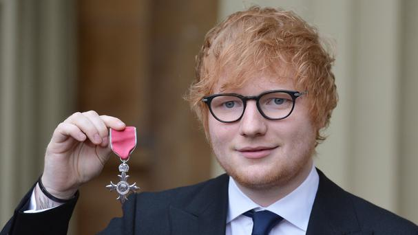 Ed Sheeran with his MBE