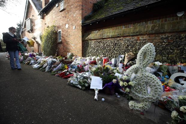 Floral tributes continue to be left outside the home of George Michael (Steve Parsons/PA)