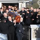 Mourners carry Dolores O'Riordan's coffin following her funeral (Niall Carson/PA)
