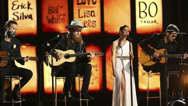 The Brothers Osborne, from left, Maren Morris and Eric Church perform at the 60th annual Grammy Awards (Matt Sayles/Invision/AP)