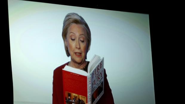"Hillary Clinton appears on screen reading an excerpt from the book ""Fire and Fury"" (Matt Sayles/Invision/AP)"
