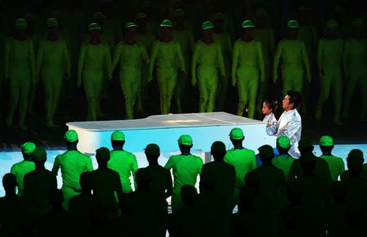 Celebration: Pianist Lang Lang performs and five-year-old Li Muzi perform at the opening of the 2008 Olympics in Beijing