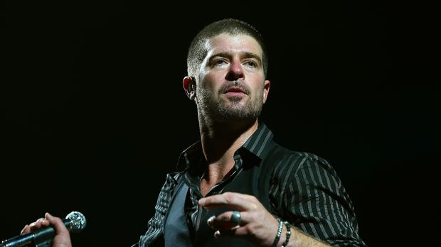 Robin Thicke is a happy man after becoming a dad again with