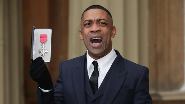 Musician Wiley, real name Richard Cowie Jnr, holds his MBE. (Yui Mok/PA)