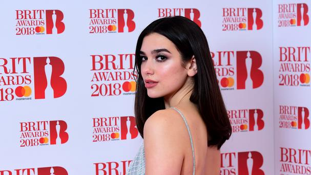 Dua Lipa is 'so upset' after pulling out of Bruno Mars gigs for dental surgery (Ian West/PA)