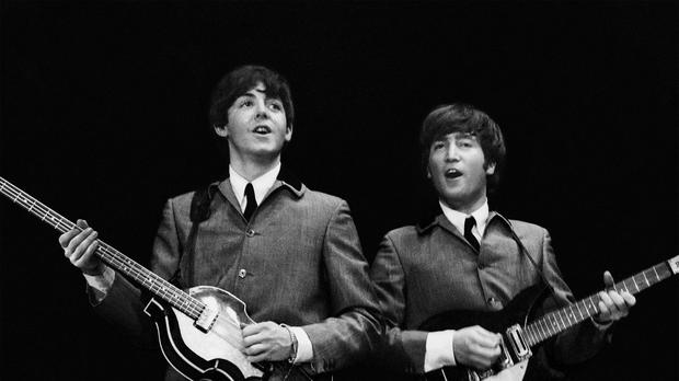 Paul McCartney (left) and John Lennon (Mike Mitchell/Omega Auctions)