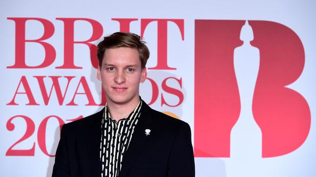 George Ezra is hoping to top the charts (Ian West/PA)