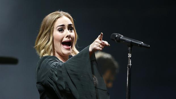 Adele confirms she married Alan Carr and his partner (Yui Mok/PA)