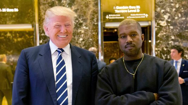 Then president-elect Donald Trump and Kanye West pose for a picture in the lobby of Trump Tower in 2016 (Seth Wenig/AP)