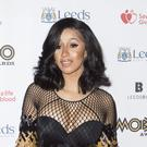 Cardi B has moved to reassure fans she will still be working despite cancelling a number of live shows due to her pregnancy (Danny Lawson/PA)