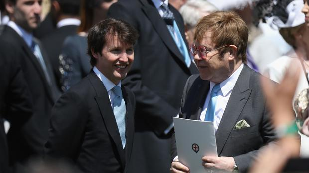 Sir Elton John and James Blunt (left) leave St George's Chapel following the wedding of Meghan Markle and Prince Harry (Chris Jackson/PA)