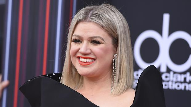 Host of the 2018 Billboard Music Awards Kelly Clarkson opened the ceremony with a call for a