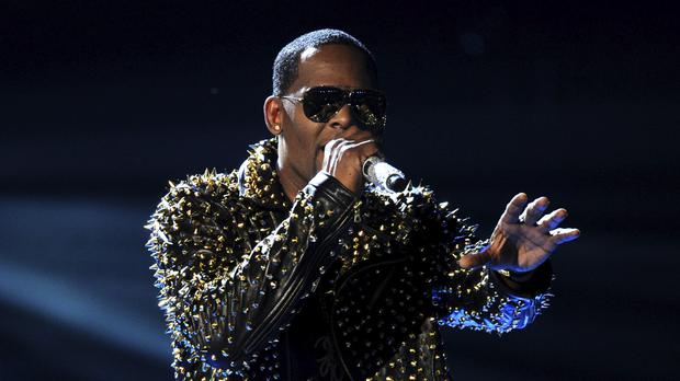 Spotify said it would remove from its playlists music from R Kelly, who has been accused of sexual abuse (Frank Micelotta/Invision/AP)
