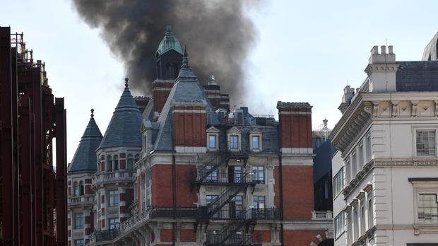 Smoke rises from the Mandarin Oriental Hotel in Knightsbridge, central London, after 97 firefighters were called to a fire (John Stillwell/PA)