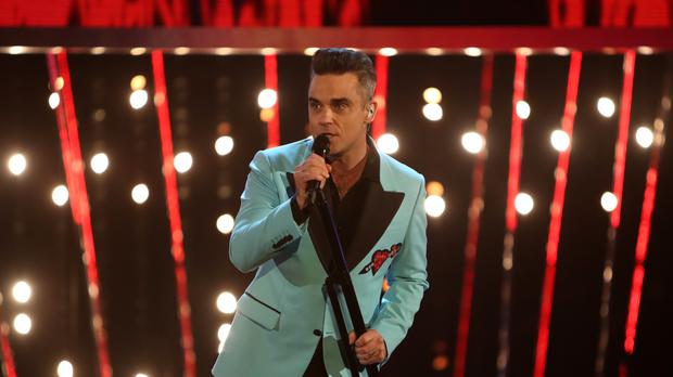 Robbie Williams will perform at the World Cup opening ceremony (David Davies/PA)